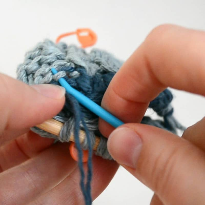 Trace your contrasting cast on yarn