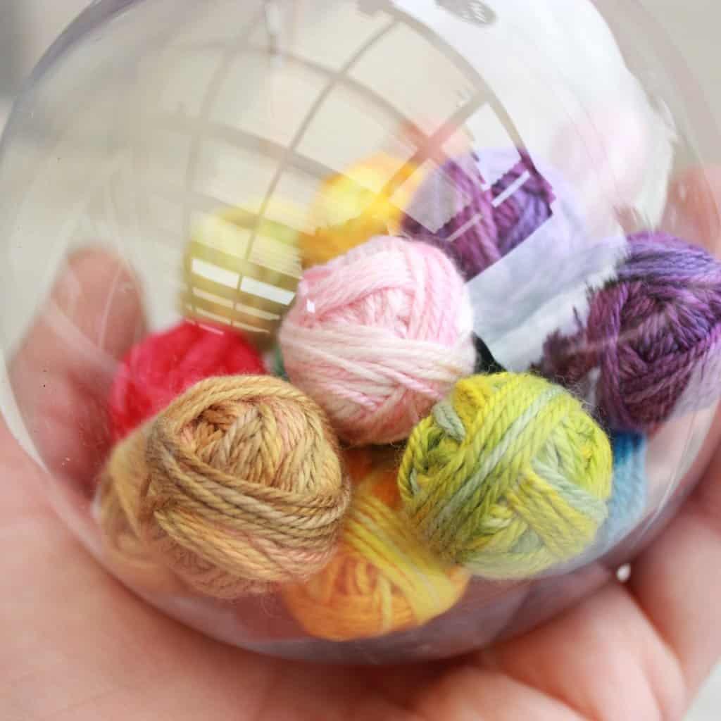 Decoration ball filled with mini yarn balls