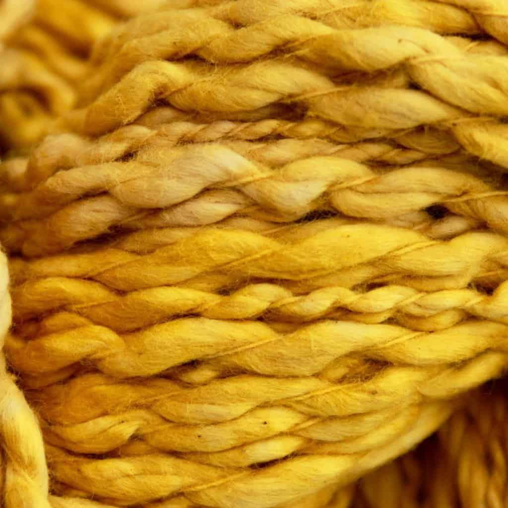 marigold dyed yarn close up