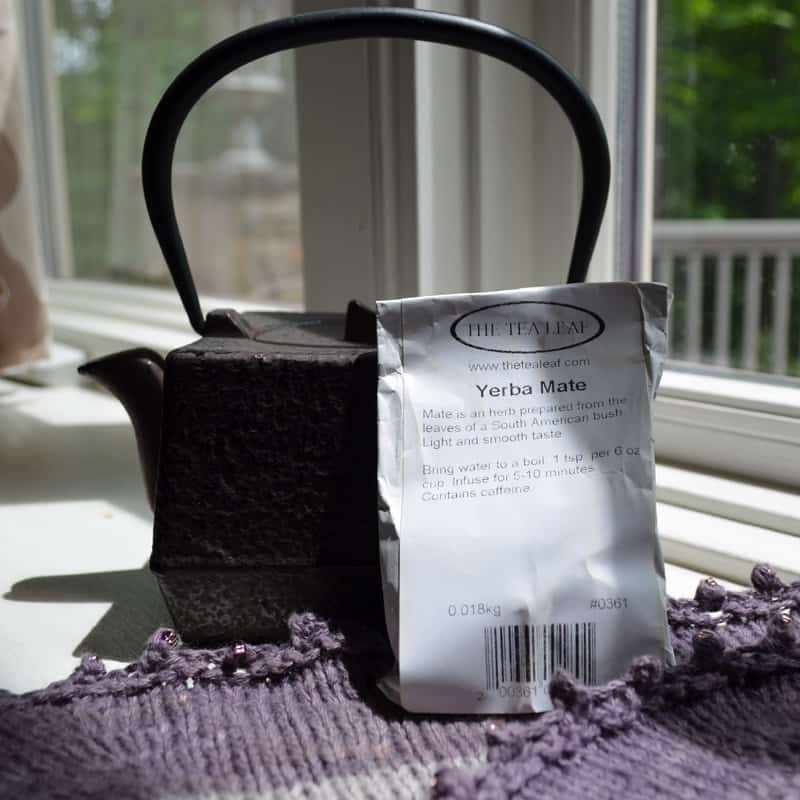 cast iron tea pot, bag of tea from the Tea Leaf and shawl