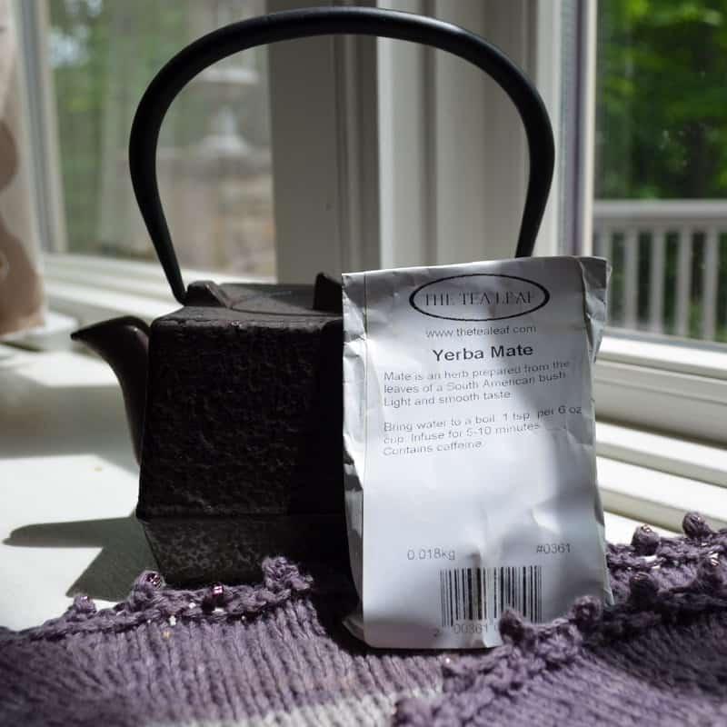 cast iron tea pot, bag of tea from the Tea Leaf and shawl