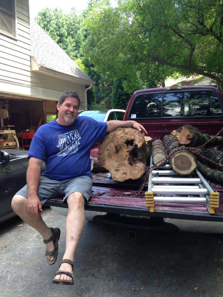 Steve in truck with wood