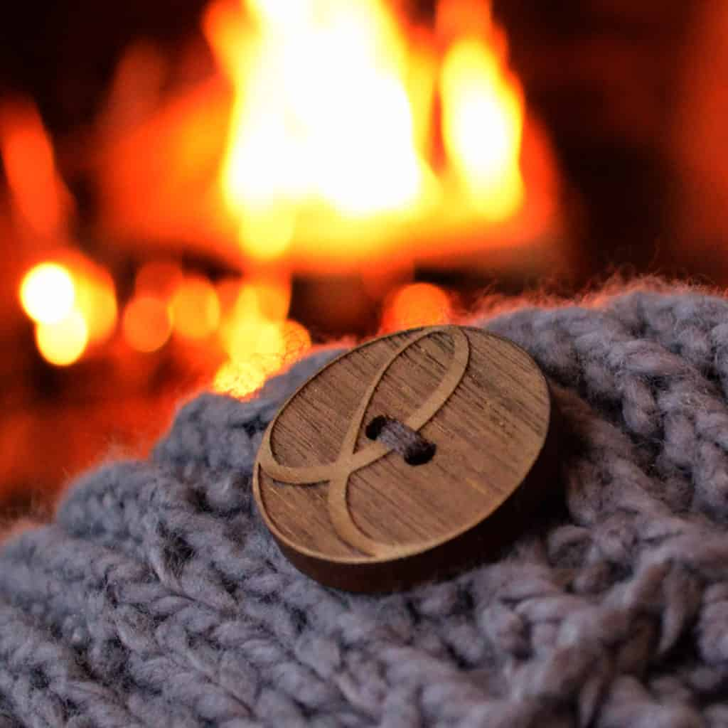 KEC logo button by fire at night